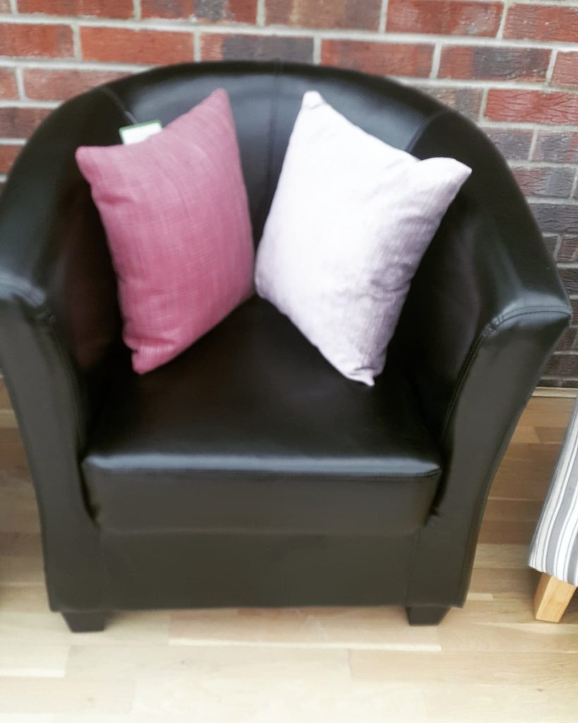 Black faux leather tub chair was £228 now £100